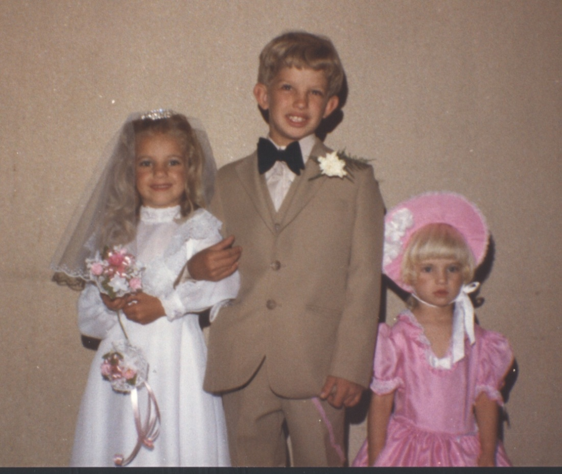 My brother, sister and myself as part of a wedding party