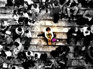 Alone in a crowd ... image was intentionally softened and colors muted to all but the alone person.